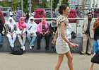 A contrast in style as a group of Saudi Arabian visitors look on as race goers make their way from Eyre Square to Ballybrit for Ladies Day at the Galway Races yesterday.