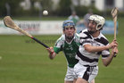 Sarsfields, Noel Kelly,<br /> and<br /> Turloughmore's, Daithi Burke,<br /> during the Senior Hurling Championship at Athenry.