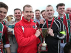 Tom Trill, Acting Chairman, Galway FA, presenting the Western Hygiene Supplies First Division trophy to Merlin Woods/Medtronic Captain Keith Costelloe at Millers Lane last Sunday.