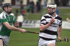 Sarsfields, Eamon Cleary,<br /> and<br /> Turloughmore's, Gary Burke,<br /> during the Senior Hurling Championship at Athenry.