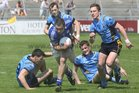 Salthill-Knocknacarra's, John Boylan, Gary Cox, Eoin O'Mahoney and Sean Gavin,<br /> and<br /> St. Michaels, Jamie Downes,<br /> during the Senior Football Championship at Pearse Stadium.