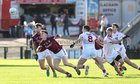 Galway v Cork Allianz Football League Division 2 Round 1 game at the Pearse Stadium.<br /> Galway's Michael Day and Paul Conroy, and Cork's Aidan Walsh, Ruairi Deane and Mark Collins
