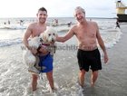 Tony and Tom Treacy, Salthill, with Goldendoodle Bonnie after their Christmas Day Swim at Blackrock.