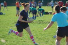 Action from week 2 of Tag Rugby at Galway Corinthians<br /> <br /> Jess Foley of Fidelity Flyers in their match against The Scrummie Dummies
