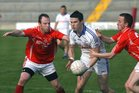 <br /> Kilkerrin-Clonberne's, Shane Walsh and Sean Collins,<br /> and<br /> Micheal Breathnach's, Sean Denvir,<br /> during the Senior Football Championship at Pearse Stadium.