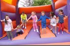 <br /> Children on the Bouncy Castle, at the St. Nicholas Garden Fete at the Rectory Taylors Hill.