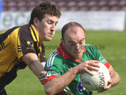 Kilconly's, Alan Walsh,<br /> and<br />  Leitir Moir's, Patrick Mark O Fatharta,<br /> during the Senior Football Championship at Pearse Stadium.