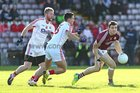 Galway v Cork Allianz Football League Division 2 Round 1 game at the Pearse Stadium.<br /> Galway's Damien Comer and Cork's Tom Clancy and Ruairi Deane