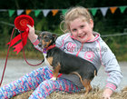 "Edel Nee (8) from Cashel with her first prize winning Jack Russell ""Holly"" at the annual Maam Cross Connemara Pony Show dog show."