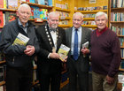 Padraic McCormack at the launch of his book, 'Beneath the Silence', with Cllr Donal Lyons, Deputy Mayor of Galway, Tom Curley, Percy Frency Society, Galway, and Joe McCarthy, founder of Renmore Pantomime Society, in Charlie Byrne's Bookshop.