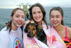 Sisters Elizabeth and Jane Ryan from Barna with their dog Billy Murphy, and their friend Andrea Shaughnessy, also from Barna, after their swim at Blackrock on Christmas Day.