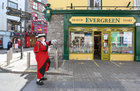 Galway Town Crier Liam Silke outside Evergreen when he was out on the city centre streets on Monday welcoming back shoppers and thanking staff and business owners, who have been able to reopen, after the easing of Covid-19 restrictions.