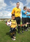 Ballinasloe Town captain Peter Keighery with his son Cameron who was team mascot at the Connacht Junior Cup final against Athenry FC at Lecarrow, Roscommon, last Sunday.