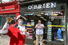 Paul O'Brien of O'Brien's Newsagents on William Street applauds Galway Town Crier Liam Silke who was out on the city centre streets on Monday welcoming back shoppers and thanking staff and business owners who have been able to reopen after the easing of Covid-19 restrictions. O'Brien's also celebrated the 40th anniversary of their shop opening on Monday.