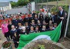 Deputy Sean Kyne, raises the Green Flag at Tuairin' National School Moycullen. Also in the picture are: Tiernan, McCluskey, Mark Ryan, Principal; Anne Carroll, Vice Principal and pupils.