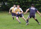 Action from week 3 of Tag Rugby at Corinthians<br /> <br /> Ronan Mannion of CoCo Nuts tries to get past Evaldas Augustus of SMc Fitness, watched by Mark Casey