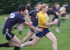 Action from week 3 of Tag Rugby at Corinthians<br /> <br /> Norma Carty of CoCo Nuts tries to get past Evaldas Augustus of SMc Fitness