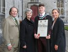 Stephen McEnery from Claddagh with his parents Brian McEnery and Catherine Connolly TD and Claire Connolly, after he was conferred with a B A Honours degree at NUI Galway.