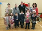 Committee members of the Ballybane Task Force with local children at the Ballybane Christmas Fair in the local Community Centre last Saturday. From left: Mary Ward, Bridget McDonagh, Donal Lynch, Elaine Harvey and Imelda Gormally.