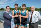 Catherine Wall, presenting the Henry Wall Medal to Daniel Mac An Úcaire and Mac Dara Allison of Colaiste na Coiribe Rowing Club after they won the Junior 18 Doubles event at the Galway Regatta. Included in the photograph is Paddy Cronin of Galway Rowing Club, organisers of the regatta.