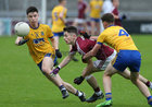 Galway v Roscommon Minor Football semi-final at the Pearse Stadium.<br /> Galway's Gavin Burke and Roscommon's Cathal Heneghan and Gerry Galvin