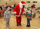 Mercedes (7) and Richard Ward (5) from Ballybane meeting with Santa Claus at the Ballybane Christmas Fair in the Ballybane Community Centre last Saturday.