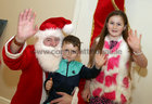 Santa Claus with Frankie Barrett (3) and his cousin Naomi Mongan (8), both from from Ballybane, at the Ballybane Christmas Fair in the Ballybane Community Centre last Saturday.