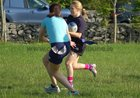 Action from week 2 of Tag Rugby at Galway Corinthians<br /> <br /> Ruth Devanny of Fidelity Flyers in their match against The Scrummie Dummies