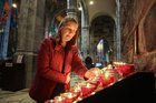 Una O'Connell of Barr na Cluana, Headford Road, lights a candle at the annual Solemn Novena at Galway Cathedral