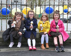 Eva Ní Mhathúna, Ciara Nic Lochlainn, Ruth Ní Gallachóir and Mary Kate Ní Fhathaigh, Naíonáin Bheaga, relaxing with their ice cream cones during break at Scoil Fhursa which reopened on Monday.