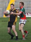 <br /> Kilconly's, Martin Newell,<br /> and<br />  Leitir Moir's, Fiachra Breathnach,<br /> during the Senior Football Championship at Pearse Stadium.