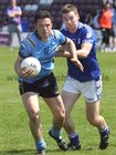 <br /> Salthill-Knocknacarra's, Alan Kerins,<br /> and<br /> St. Michaels, Keillan Clancy,<br /> during the Senior Football Championship at Pearse Stadium.