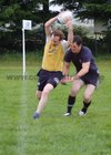 Action from week 3 of Tag Rugby at Corinthians<br /> <br /> Ronan Mannion of CoCo Nuts tries to get past Evaldas Augustus of SMc Fitness