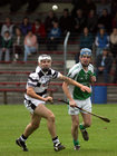 Sarsfields, Noel Kelly,<br /> and<br /> Turloughmore's, Brian Holland,<br /> during the Senior Hurling Championship at Athenry.