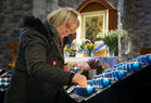 Lighting a candle at the Solemn Novena to Our Lady of Perpetual Help at Galway Cathedral this week.