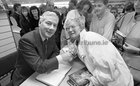Gay Byrne meeting with members of the public while signing copies of his book 'The Time of My Life' in the Eason Bookshop in Shop Street in October 1989.