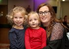 Lisa Devery, Castlepark, with her daughters Mollie (left) and Robyn at Merlin Park Hospital Tea Dance at the Clayton Hotel.