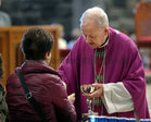 Bishop Brendan Kelly gives out holy communion at the Solemn Novena to Our Lady of Perpetual Help at Galway Cathedral.