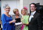 Aine Burke, Cara Diamonds presents Sacha Curran, Roscam, with her prize for the best dressed lady at the Clayton Hotel on Ladies at Ballybrit. Also in the picture are Judge Tracy Piggott and Darragh O'Connor, Clayton Hotel.