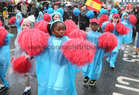School children brave the wet weather while taking part in the St Patrick's Day Parade at Eyre Square.