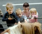 <br /> Fionnuala Coppinger, Clarinbridge, with her children Dylan, Casey and Sienna, playing with a pony, at the Clarinbridge Market Day.