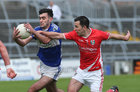 Tuam Stars v Killannin Senior Football Championship game at the Pearse Stadium.<br /> Killannin's Gary Heffernan and Noel Henry, Tuam Stars