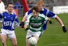 Kilconly's, Kevin Brady and James Fair,<br /> and<br /> Oughterard's, Martin Coady,<br /> during the Intermediate Football Championship Final<br /> Replay at Pearse Stadium.<br />
