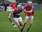 <br />  Clarinbridge's, Paul Coen,<br />  and<br />  St. Thomas, Robert Murray,<br />  during the Senior Hurling Championship at Athenry.<br />