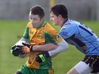 Corofin's, Michael Lundy,<br /> and<br /> Salthill-Knocknacarra's, Sean Hughes,<br /> during the County U-21(A) Football Championship Final at Tuam Stadium.<br />