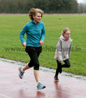 Mary Clifford and her daughter Grace from Moycullen taking part in the GOAL Mile at Dangan on Christmas Day.