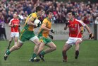 <br /> Corofin's, Kieran Fitzgerald,<br /> and<br /> Tuam Stars, Noel Henry,<br /> during the County Senior Football Championship Final<br /> at Tuam Stadium.<br />