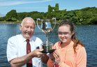 Paddy Cronin of Galway Rowing Club, organisers, presenting the Moore Cup to Ellen Forde of Colaiste Iognaid Rowing Club who won the Junior 16 Sculls event at the Galway Regatta.
