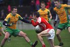 <br /> Corofin's, Gary Delaney and Michael Lundy,<br /> and<br /> Tuam Stars, Declan Byrne,<br /> during the County Senior Football Championship Final<br /> at Tuam Stadium.<br />