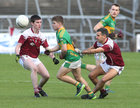 Claregalway v Williamstown Intermediate Football Championship final at the Pearse Stadium.<br /> Barry Golderick, Claregalway and Paul Hevican and Jason Kirrane, Williamstown